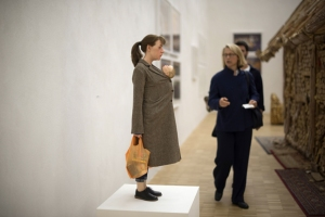 A woman looks at a sculpture of a woman and child displayed at the Arts and Foods Pavilion at the Triennale of Milan, on April 9, 2015, part of Expo Milan 2015. The Arts an Foods Pavilion will focus on all the visual, sculptural, object-based and environmental forms that, ever since 1851, the year of the first Expo in London, have revolved around the world of food, nutrition, and dining together. AFP PHOTO / OLIVIER MORIN RESTRICTED TO EDITORIAL USE, MANDATORY MENTION OF THE ARTIST UPON PUBLICATION, TO ILLUSTRATE THE EVENT AS SPECIFIED IN THE CAPTION (Photo credit should read OLIVIER MORIN/AFP/Getty Images)